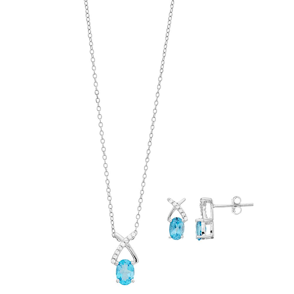 Women's 7mm X 5mm Oval Blue Topaz Pendant and 6mm X 4mm Oval Blue Topaz Earrings Set in Sterling Silver