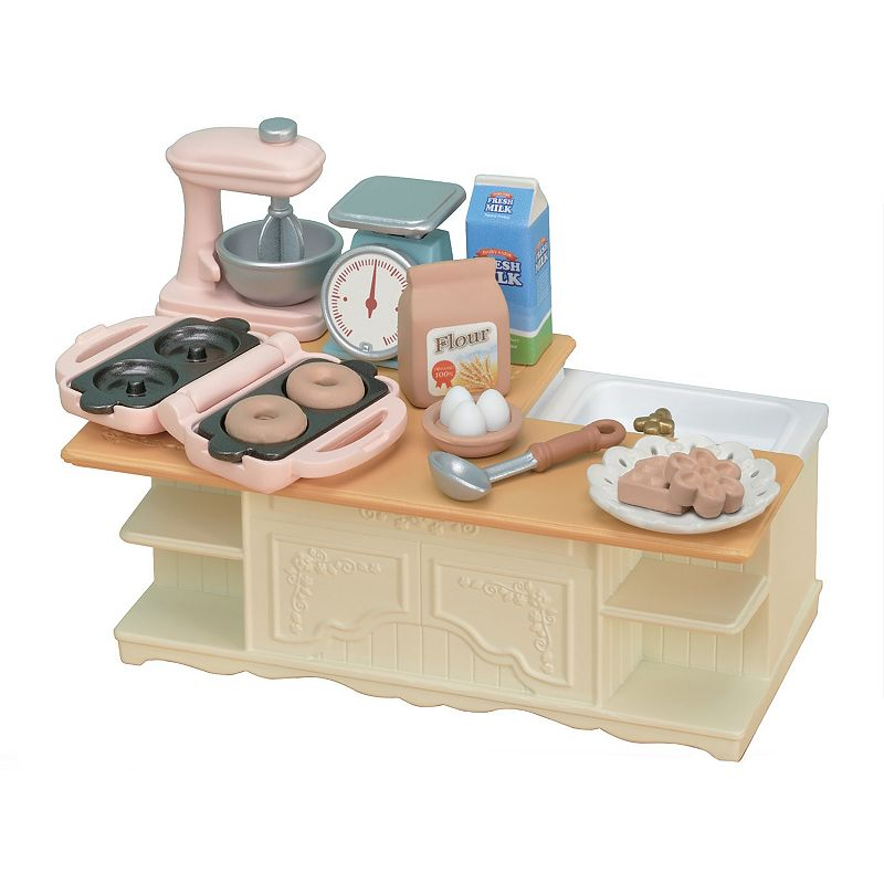 Calico Critters Kitchen Island Add to your Calico world with this Calico Critters Kitchen Island. The Calico Critters Kitchen Island playset includes a kitchen island with sink and kitchen appliances with special features. The island is accessible from many different directions is the perfect place to make donuts or waffles with the entire family. Many accessories have special features and realistic moving parts including the measuring scales that move up and down, a turnable mixer, and a waffle/donut maker with exchangeable molds. Have even more fun playing together with our other kitchen furniture and designs (sold separately). WHAT'S INCLUDED 18 pieces including - kitchen island, mixer, waffle/donut maker, waffle mold, donut mold, ladle, waffle (house), waffle (flower), donut x 2, eggs, flour, mixing bowl, measuring scale, plate, milk 6.6x2.4x3.8 inches Age: 3 years & up Plastic Spot clean Imported Size: One Size. Color: Multicolor. Gender: female. Age Group: kids.