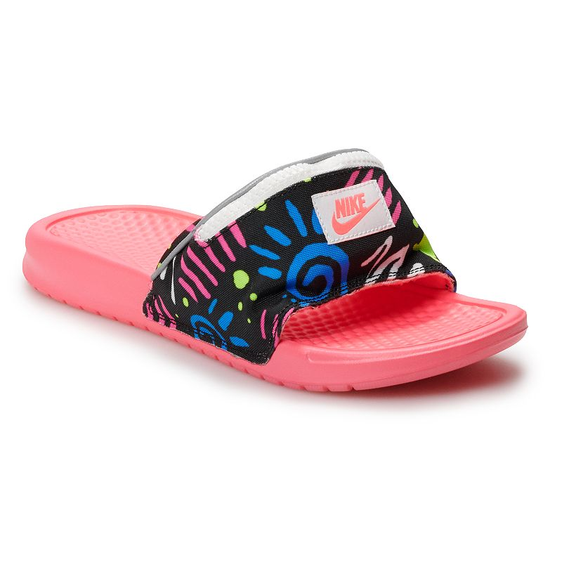 Nike Benassi JDI Fanny Pack Women's Printed Sandals, Size: 11, Red These Nike Benassi JDI Fanny Pack printed slides are lightweight sandals with a zip pocket on the strap to keep small items secure while you're on the go. These Nike Benassi JDI Fanny Pack printed slides are lightweight sandals with a zip pocket on the strap to keep small items secure while you're on the go. SHOE FEATURES Phylon foam midsole and a textured footbed provide lightweight comfort Herringbone outsole pattern offers flexibility and traction Woven fabric strap offers durability Zip pocket on the strap keeps small items secure SHOE CONSTRUCTION Fabric upper Foam midsole & outsole SHOE DETAILS Open toe Slip-on Foam footbed Size: 11. Gender: female. Age Group: adult.