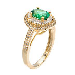 14k Gold Emerald & 1/2 Carat T.W. Diamond Oval Halo Ring