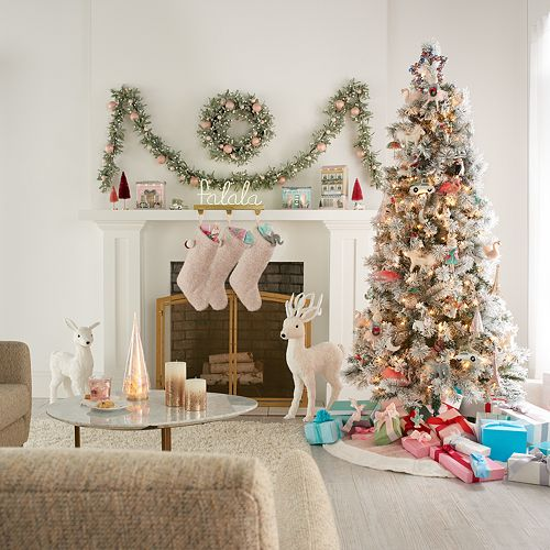 LC Lauren Conrad Herringbone Christmas Tree Skirt in a living room with pastel holiday decor and cheerful colors.