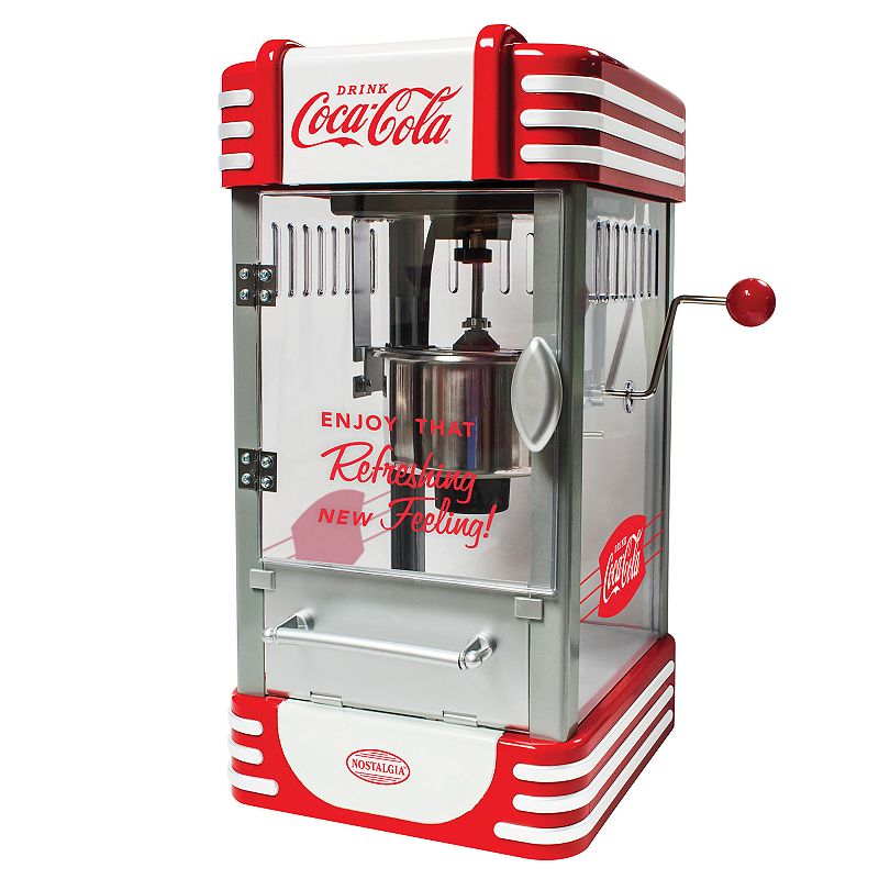 Nostalgia Electrics Coca-Cola 2.5-oz. Kettle Popcorn Maker, Red Make hot, fresh and delicious popcorn just like in the movie theaters with this Nostalgia Electrics Coca-Cola kettle popcorn maker. Make hot, fresh and delicious popcorn just like in the movie theaters with this Nostalgia Electrics Coca-Cola kettle popcorn maker. Perfect for use with all Nostalgia Popcorn Kits! (Theater Hot Air & Kettle Kit-KPK400, PCJ30-Soft shelled Popping Kernels, PPB600-Reusable Popcorn Bowls, PCSP5-Pre-Measured Coconut Oil Popcorn Kit) Pops up to 10-cups of popcorn per batch Large 2.5-ounce dual-hinged stainless steel kettle with built-in stirring system 360° clear-view popping chamber with vented windows Lighted interior for easy viewing and countertop ambiance Tilt door for easy serving access WHAT'S INCLUDED Kernel measuring cup & oil measuring spoon PRODUCT CARE Manufacturer's 1-year limited warrantyFor warranty information please click here 19.5 H x 10 W x 12 D 300 watts 36-in. cord length Model no. RKP630COKE This product may contain a chemical known to the state of California to cause cancer, birth defects or other reproductive harm. For more information go to www.P65Warnings.ca.gov. Size: One Size. Gender: unisex. Age Group: adult.