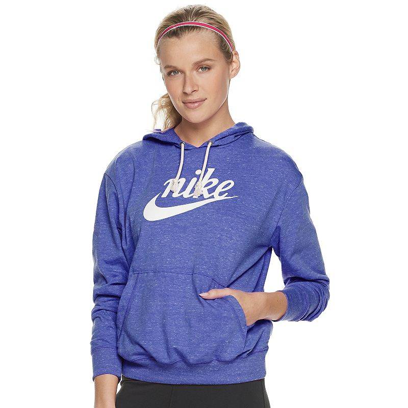 Made from a lightweight cotton and recycled polyester, this women\\\'s Nike Sportswear hoodie elevates a wardrobe staple with heritage vibes and a soft, comfortable fit. Made from a lightweight cotton and recycled polyester, this women\\\'s Nike Sportswear hoodie elevates a wardrobe staple with heritage vibes and a soft, comfortable fit. Watch the product video here. Raw edge knotted drawcord and script logo on chest have a vintage look Long sleeves 2-pocketFABRIC & CARE 60% cotton, 40% recycled polyester Machine wash Imported Size: Medium. Color: Purple. Gender: female. Age Group: adult. Material: Fleece.