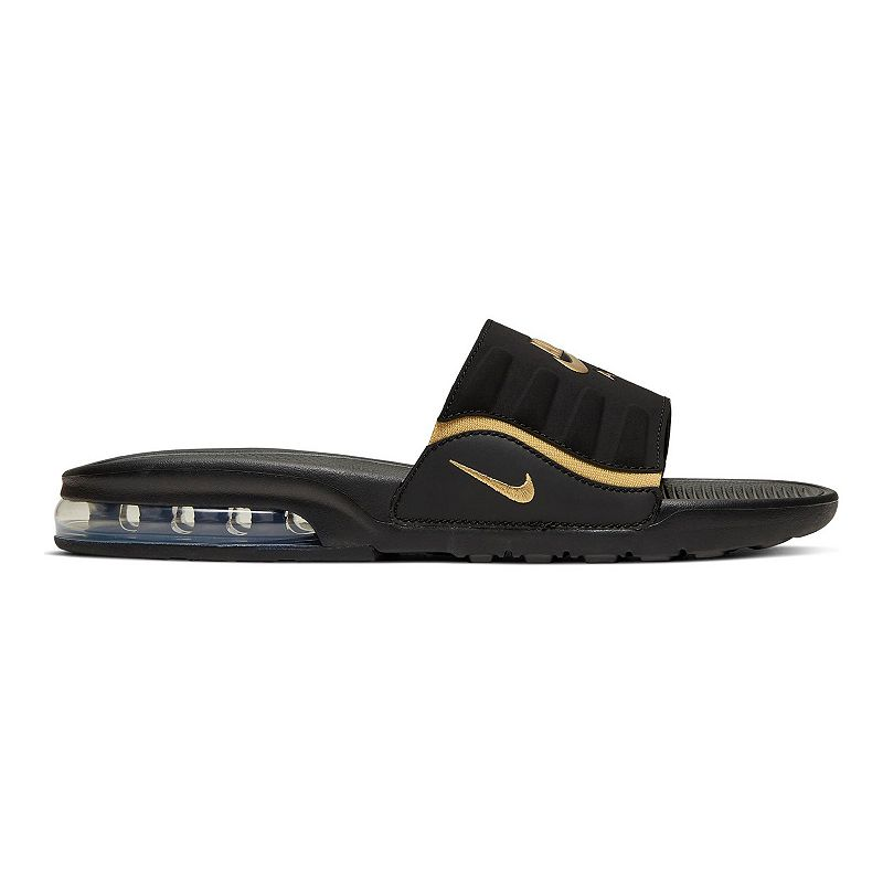 Nike Air Max Invigor Women's Slides, Size: 12, Black Inspired by an icon, these Nike Air Max Invigor Slides use soft foam, deep flex grooves and a cushioned upper strap to give you 360 degrees of comfort. Inspired by an icon, these Nike Air Max Invigor Slides use soft foam, deep flex grooves and a cushioned upper strap to give you 360 degrees of comfort. SHOE FEATURES Gore strap offers a snug, dynamic fit Deep flex grooves in the outsole bend with your foot A Max Air unit adds style and provides all-day, cushioned support Details on the midsole/outsole and strap hearken back to the original Air Max Invigor SHOE CONSTRUCTION Manmade upper Phylon midsole and outsole SHOE DETAILS Open toe Slip-on Foam footbed Size: 12. Color: Black. Gender: female. Age Group: adult.