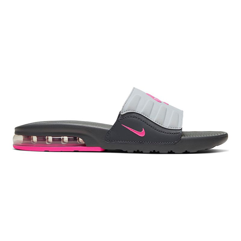 Nike Air Max Invigor Women's Slides, Size: 8, Oxford Inspired by an icon, these Nike Air Max Invigor Slides use soft foam, deep flex grooves and a cushioned upper strap to give you 360 degrees of comfort. Inspired by an icon, these Nike Air Max Invigor Slides use soft foam, deep flex grooves and a cushioned upper strap to give you 360 degrees of comfort. SHOE FEATURES Gore strap offers a snug, dynamic fit Deep flex grooves in the outsole bend with your foot A Max Air unit adds style and provides all-day, cushioned support Details on the midsole/outsole and strap hearken back to the original Air Max Invigor SHOE CONSTRUCTION Manmade upper Phylon midsole and outsole SHOE DETAILS Open toe Slip-on Foam footbed Size: 8. Color: Oxford. Gender: female. Age Group: adult.