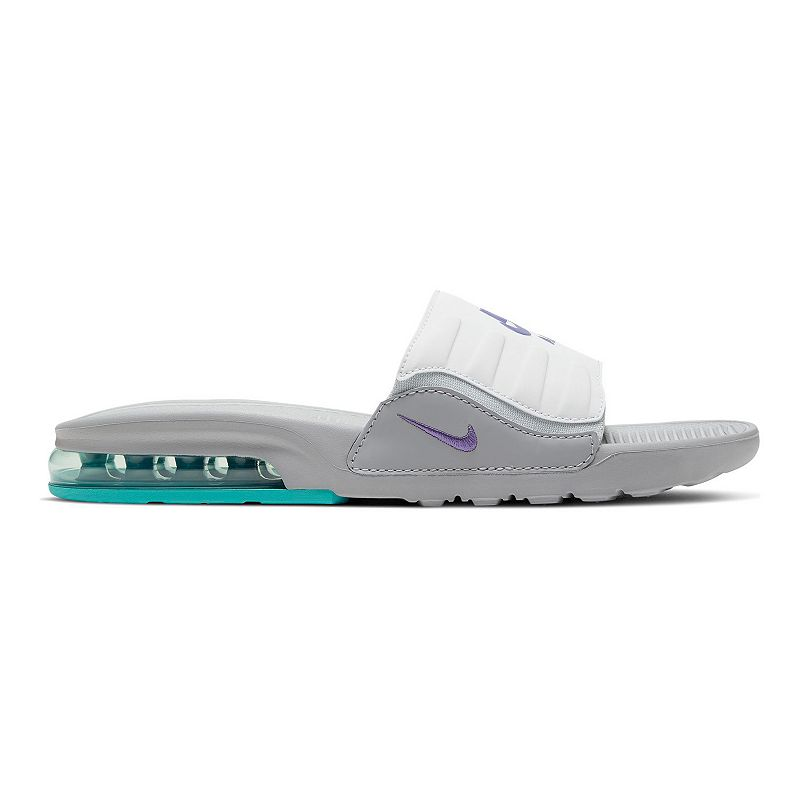 Nike Air Max Invigor Women's Slides, Size: 6, Oxford Inspired by an icon, these Nike Air Max Invigor Slides use soft foam, deep flex grooves and a cushioned upper strap to give you 360 degrees of comfort. Inspired by an icon, these Nike Air Max Invigor Slides use soft foam, deep flex grooves and a cushioned upper strap to give you 360 degrees of comfort. SHOE FEATURES Gore strap offers a snug, dynamic fit Deep flex grooves in the outsole bend with your foot A Max Air unit adds style and provides all-day, cushioned support Details on the midsole/outsole and strap hearken back to the original Air Max Invigor SHOE CONSTRUCTION Manmade upper Phylon midsole and outsole SHOE DETAILS Open toe Slip-on Foam footbed Color: Oxford. Gender: female. Age Group: adult.
