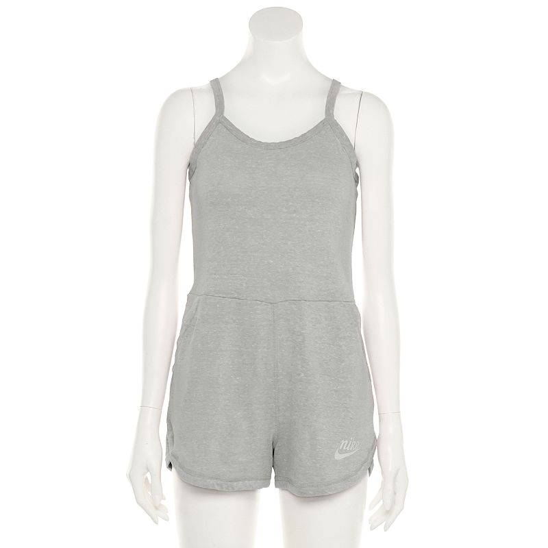 Vintage style. Getting dressed is as easy as one-and-done with this women\\\'s Nike romper. Made from soft cotton jersey, it\\\'s comfortable and casual for fun in the sun. Vintage style. Getting dressed is as easy as one-and-done with this women\\\'s Nike romper. Made from soft cotton jersey, it\\\'s comfortable and casual for fun in the sun. Scoopneck Sleeveless Curved hem gives you a fun, athletic look Jersey construction is soft and comfortable for all-day wear. Side seam pockets offer convenient storage for your phone, keys and idle handsFABRIC & CARE 60% cotton, 40% recycled polyester Machine wash Imported Size: Large. Color: Grey. Gender: female. Age Group: adult. Material: Cotton Blend.