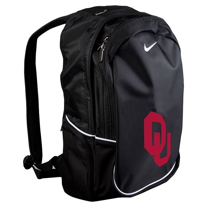 Nike Oklahoma Sooners Backpack, Black Spacious main compartment, side pocketsand front organizer pouch keep your textbooks, supplies and gadgets handy. Padded adjustable shoulder straps conform to your liking. Microfiberconstruction ensures durable use. Details: 20H x 12W x 7D Zipper closures Adjustable shoulder straps Polyester Model no. 9N3004COS Size: One size. Color: Black. Gender: Unisex. Age Group: Adult. Material: Polyester/Embroidery.