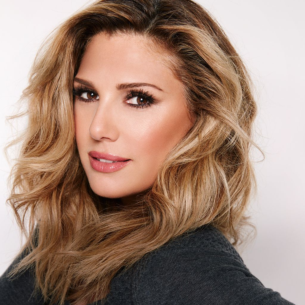 Daisy Fuentes wearing her brand's clothing