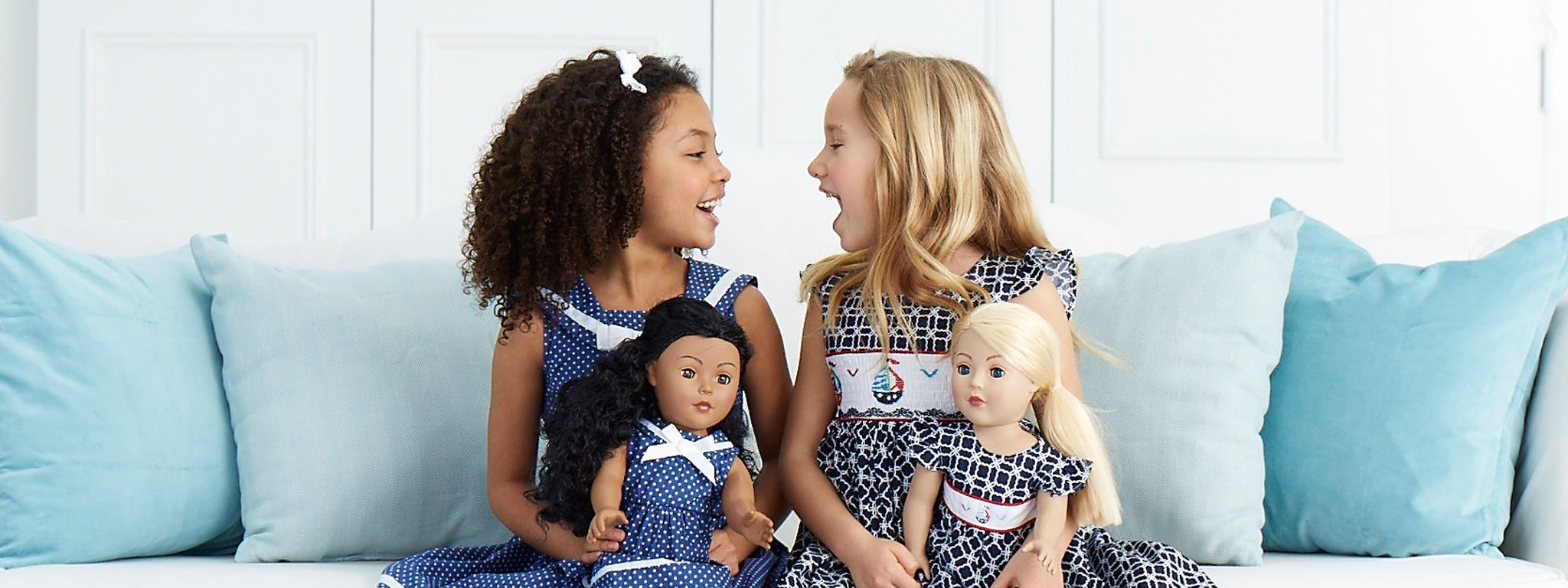 Children with Dollie & Me Dolls wearing matching dresses