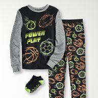boys pajama set with sports ball graphics
