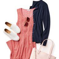 women's red print dress, with blue cardigan, white shoes, sunglasses, white handbag