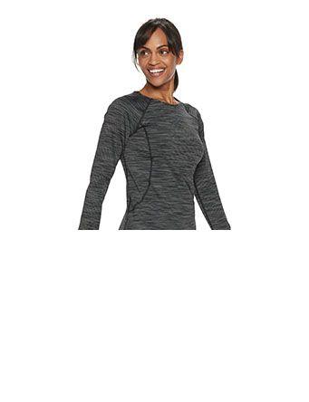 smiling woman wearing grey workout top