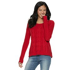 dark-haired girl in red sweater and jeans