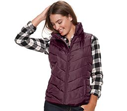 brunette wearing plaid shirt with maroon puffy vest
