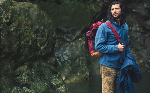 A man looking rugged out in a natural place