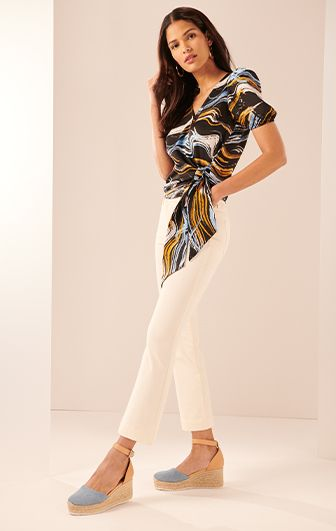 blouse with white jeans