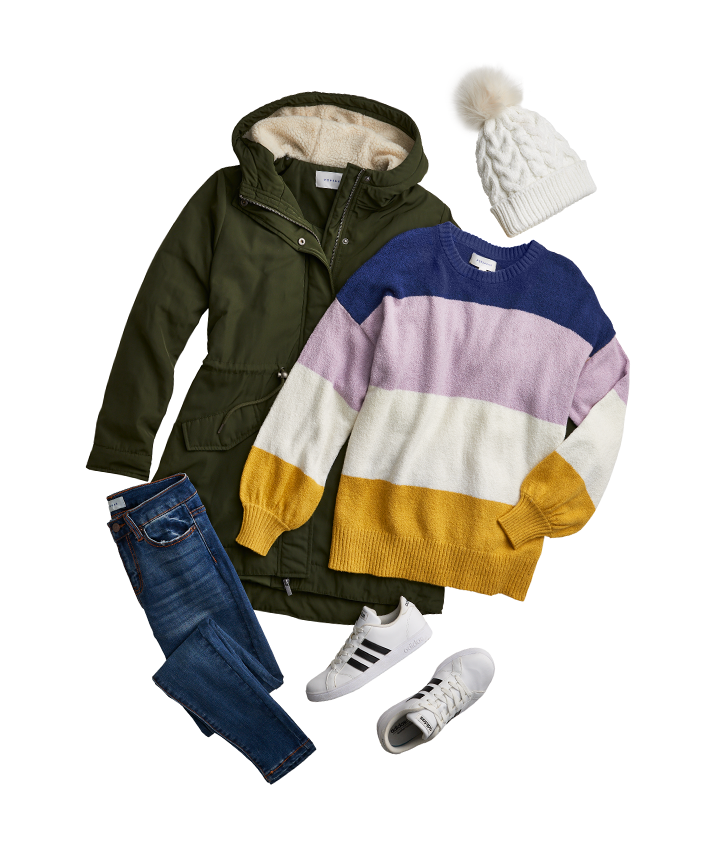 A poof-adorned knit hat, a four-color striped sweater, a tall green three-quarter length jacket, adidas kicks, a pair of denim jeans