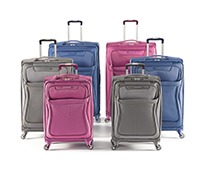 An array of blue carry-on sized luggage pieces.