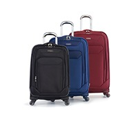 Three pieces of luggage in different colors at different sizes.